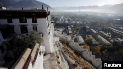 FILE - Morning mist covers downtown as seen from atop the Potala Palace in Lhasa, Tibet Autonomous Region, China.