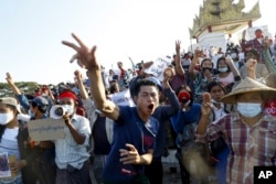 Demonstrators flash a three-fingered symbol of resistance against the military coup and shout slogans calling for the release of detained Myanmar leader Aung San Suu Kyi during a protest in Mandalay, Myanmar on Feb. 10, 2021.