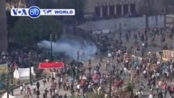 Tear gas rises as protesters clash with riot police near Cairo's Tahrir Square.