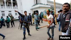 Police try to stop activists of ruling party Bangladesh Awami League from attacking lawyers loyal to Bangladesh Nationalist Party (BNP) and Bangladesh Jamaat-E-Islami during a protest inside the premises of Supreme Court in Dhaka, Dec. 29, 2013.
