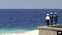 Vietnamese navy personnel patrol on Truong Sa islands or Spratly islands in this April 13, 2010 picture.