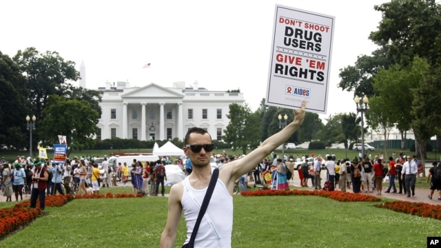 Vincent Leclercq of France demonstrates in front of the White House in Washington as the AIDS conference continues in Washington, July 24, 2012.
