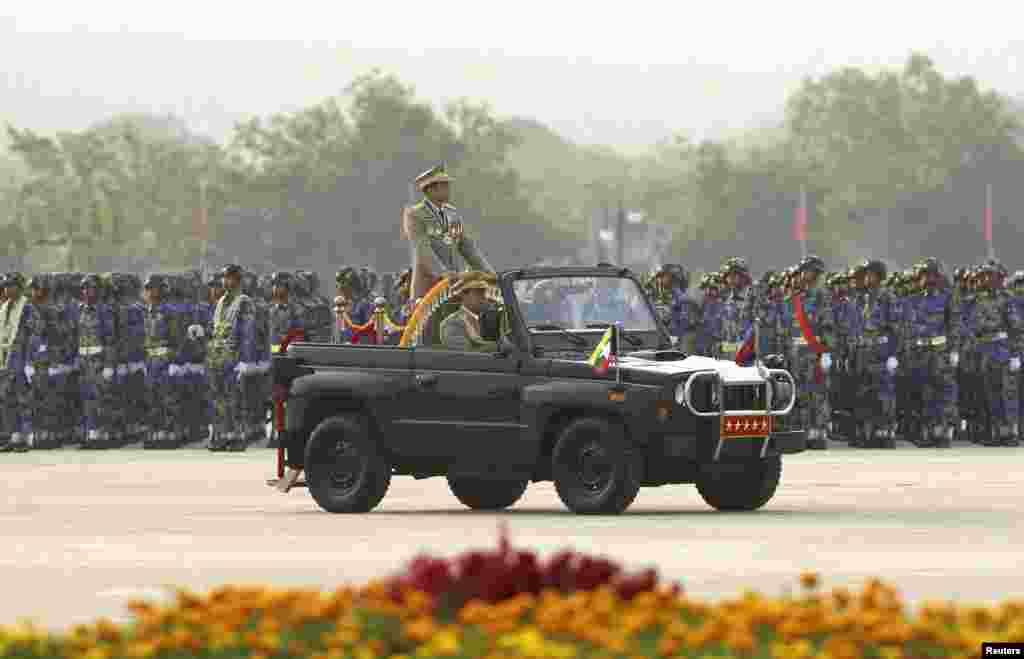 Burma's army chief Senior General Min Aung Hlaing inspects troops during a parade to mark the 68th anniversary of Armed Forces Day in Naypyitaw, March 27, 2013.