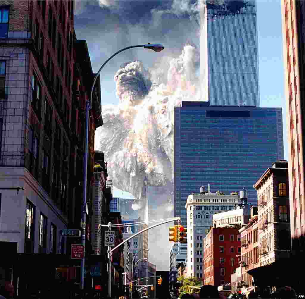 (FILE)The south tower of the World Trade Center collapses sending dust and smoke into the streets 11 September, 2001, in New York. Two planes crashed into the towers which later collapsed. AFP PHOTO/Aaron MILESTONE (Photo by AARON MILESTONE / AFP)