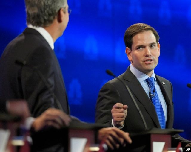 Marco Rubio, right, and Jeb Bush, argue a point during the CNBC Republican presidential debate at the University of Colorado, Wednesday, Oct. 28, 2015.