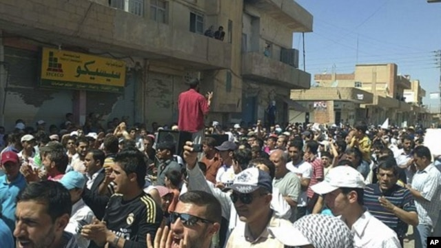Syrians protest against President Bashar al-Assad after Friday prayers in the city of Amude, August 26, 2011.