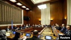 An overview of the room where Staffan de Mistura, the U.N. mediator for Syria, and the Syrian delegation, led by Syrian Ambassador to the U.N. Bashar Jaafari, opened the Syrian peace talks at the U.N. European headquarters in Geneva, Switzerland, Jan. 29,
