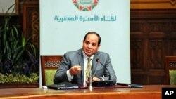 FILE - Egyptian President Abdel-Fattah el-Sissi, speaks during a live broadcast, in Cairo, Egypt. Under Sissi, The military has taken the lead in carrying out a string of major projects, from building roads and overseeing housing construction to providing cheap food to the public.