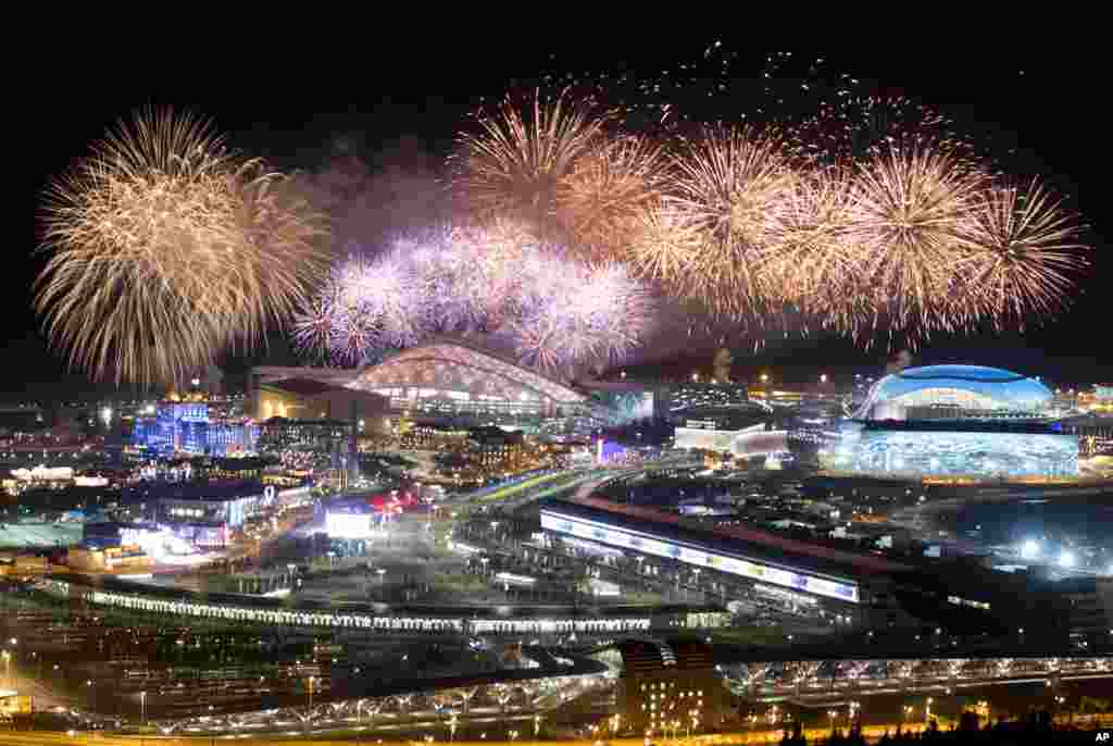 Fireworks explode over Olympic Park at the end of the closing ceremony for the 2014 Winter Olympics, Feb. 23, 2014.