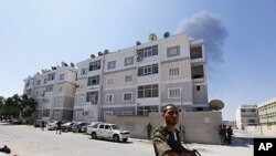 Rebel fighters secure a largely abandoned residential area during fighting in Abu Slim in Tripoli August 25, 2011
