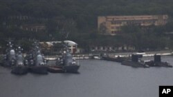 Russian naval warships, submarines berthed at port in the eastern city of Vladivostok, Sept. 5, 2012.