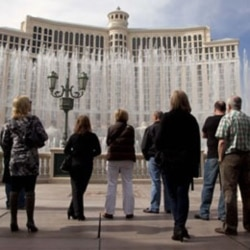 Visitors watch the dancing fountain at the Bellagio Hotel and Casino in Las Vegas, Nevada