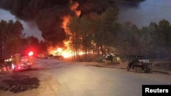First responders are at the scene of Colonial Pipeline Co. explosion and fire in this Alabaster Fire Department photo in Shelby, Alabama, Oct. 31, 2016.