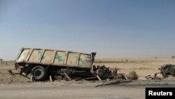 伊拉克保安部队的遇袭烧坏的车辆(2014年8月26日)