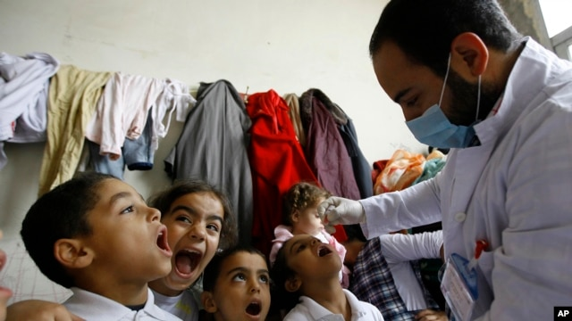Syrian children receive vaccination against polio at a Syrian refugee camp in Lebanon, Nov. 7, 2013.