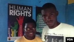 George Freeman (glasses) and co-worker Bernard Wilson at their Freetown office. (VOA - N. deVries)