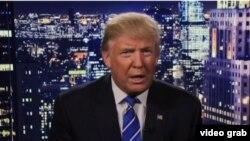 Donald Tramp üzə çıxan videoda dediklərinə görə üzr istəyib.