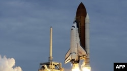 The space shuttle Atlantis lifts off from the Kennedy Space Center Friday, July 8, 2011, in Cape Canaveral, Fla. Atlantis is the 135th and final space shuttle launch for NASA. (AP Photo/John Raoux)