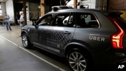 An Uber driverless car is displayed in a garage in San Francisco, Dec. 13, 2016. Uber announced Dec. 22, 2016, it is moving its self-driving cars to Arizona.