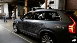 In this file photo, an Uber driverless car is shown in a garage in San Francisco, Dec. 13, 2016.