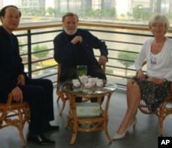 John and Doris Naisbitt with Chinese official Wang Jianzhong.