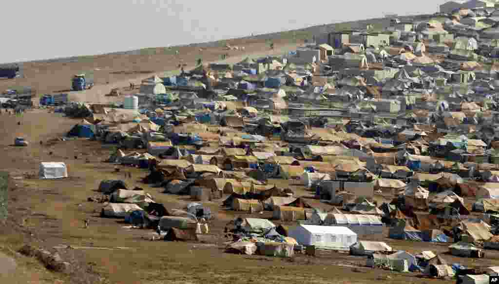 A refugee camp is seen in Syrian territory near the Turkish border town of Cilvegozu, Sept. 3, 2013.