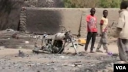 Scène de destruction après une attaque de Boko Haram.