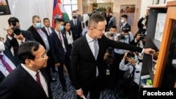 Hungarian foreign minister Peter Szijjarto and Cambodian foreign minister Prak Sokhonn during the inaugural ceremony of Hungary's embassy office in Phnom Penh, Cambodia, November 03, 2020. (Facebook Page: Peter Szijjarto)