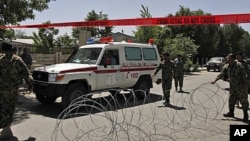 An ambulance leaves Kabul's main military hospital in Kabul, Afghanistan, Saturday, May 21, 2011