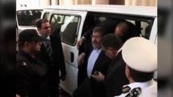 Brief Morsi Court Appearance Ends in Shouting, Protest