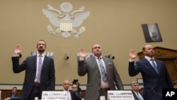 Witnesses, from left, Paul Combetta and Bill Thornton, both of Platte River Networks, and Justin Cooper are sworn in on Capitol Hill in Washington, Sept. 13, 2016, prior to a congressional panel hearing on Hillary Clinton's use of a private email server.