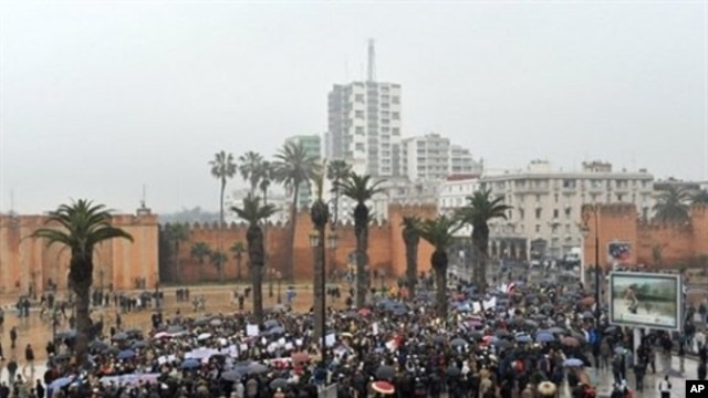 Moroccans gather during a protest demanding broad political reforms in Morocco in Rabat, February 20, 2011