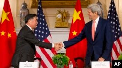 Secretary of State John Kerry, right, shakes hands with China's Vice Premier Wang Yang, left, at U.S. China Strategic and Economic Dialogue (S&ED) at the U.S. State Department in Washington, June 24, 2015.