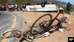 FILE - Two bikes were involved in an accident with a bus that crashed and turned on its roof near the town of Franschhoek, South Africa, March 7, 2015.