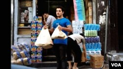 Mua bán vẫn tấp nập ở Damascus nhưng giá cả đã tăng cao