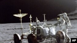 In 1971, Falcon Lunar module pilot James Irwin walks on the moon, working with the Lunar Roving Vehicle.
