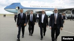 Presiden Obama dikawal pawalpres saat kunjungan ke Tampa, Florida (13/4). Beberapa anggota paswalpres diduga 'berkelakuan buruk' di Kolombia.