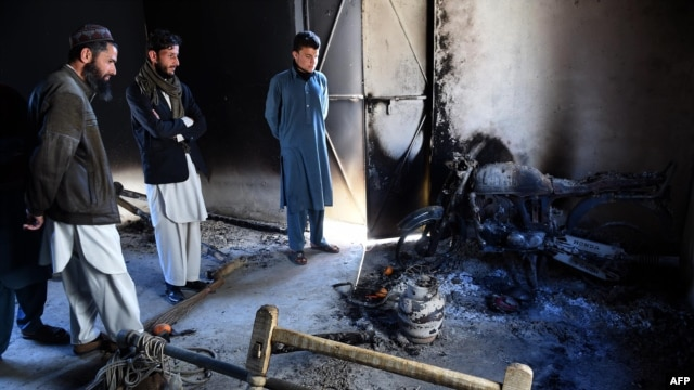 Pakistani tribesmen gather at the site following an attack by Taliban militants in Mohmand district on Feb. 18, 2016.