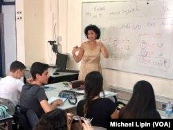 Iranian-born Israeli teacher Hanna Jahanforooz teaches Farsi to 17-year-old Israelis at the Ben Gurion High School in Petah Tikva, Israel on October 8, 2018.