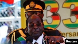 Zimbabwe President Robert Mugabe addresses crowds gathered for the country's 33rd independence celebrations at the National Sports stadium in Harare, April 18, 2013.