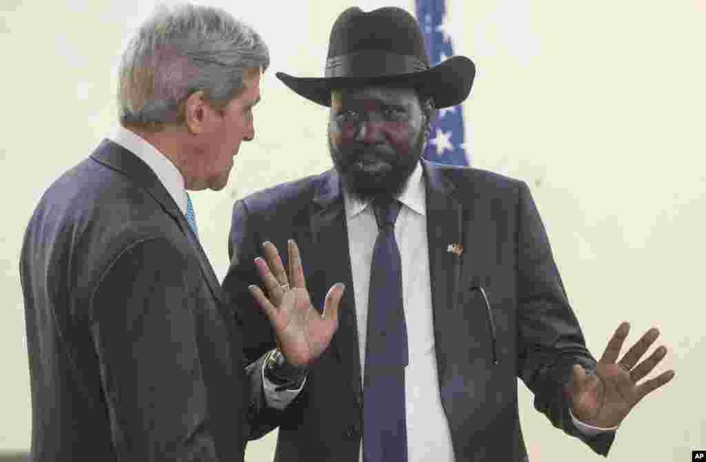South Sudan's President Salva Kiir, right, chats with U.S. Secretary of State John Kerry as he greets Kerry at the president's office in Juba, South Sudan, May 2, 2014.