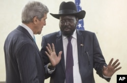 South Sudan's President Salva Kiir, right, chats with John Kerry as he greets him at the President's Office in Juba, S. Sudan, May 2, 2014.