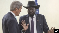 South Sudan's President Salva Kiir, right, chats with U.S. Secretary of State John Kerry as he greets Kerry at the President's Office in Juba, South Sudan, Friday, May 2, 2014. Kerry is urging South Sudan's warring government and rebel leaders to uphold a