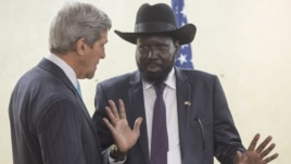 S. Sudan's President Salva Kiir chats with U.S. Secretary of State John Kerry as he greets Kerry at the President's Office in Juba, South Sudan, May 2, 2014.