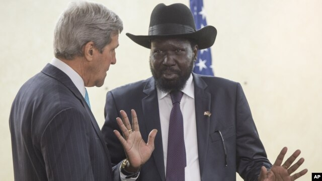 South Sudan's President Salva Kiir, right, chats with U.S. Secretary of State John Kerry during a visit to Juba on Friday, May 2, 2014.