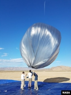 One of the balloons is being prepared for flight soon after the 2019 Ridgecrest earthquake activity. The balloons were launched from California's Mojave Desert and allowed to pass over the area. (Photo Credit: NASA/JPL-Caltech)