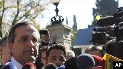希臘保守派反對黨領導人薩馬拉斯星期天在雅典對媒體發表講話