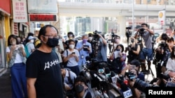Richard Tsoi, secretary of the Hong Kong Alliance in Support of Patriotic Democratic Movements of China, speaks to reporters after it was announced that the group would disband, in Hong Kong, Sept. 25, 2021.