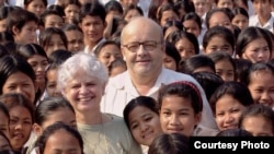 "Christian and Marie-France des Pallieres, PSE founders, took a picture with children of Cambodia at Pour un Sourire d'Enfant (PSE) also known as ""For a Child's Smile."" (Courtesy of PSE)"