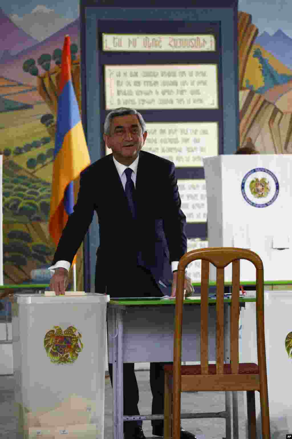 Armenian President Serzh Sargsyan casts his ballot for a parliamentary election in the Armenian capital Yerevan May 6, 2012. Armenian voters headed to the polls on Sunday for a parliamentary election its leaders hope will bolster stability and be free of